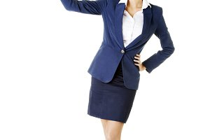 Young business woman pointing up with pen.