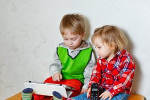 Brother and sister with tablet PC