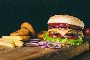 Cheeseburger, french fries and onion rings. Fast food