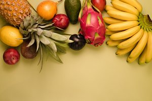 Set of fruits on a yellow background