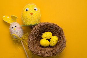 Colorful Easter eggs on a yellow background
