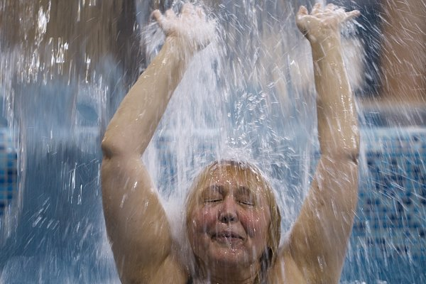 Woman splashing in a pool