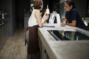 Woman offering a bottle of wine