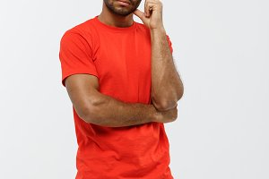 Delivery Concept - Handsome African American delivery man serious thinking of something. Isolated on Grey studio Background. Copy Space.