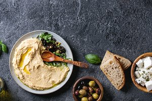 Hummus with olives and herbs