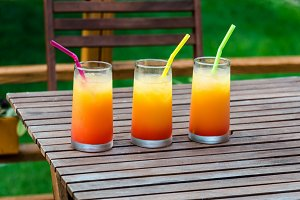 Three tequila sunrise cocktails