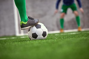 The leg of soccer football player