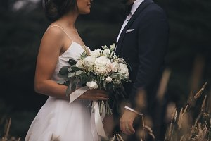 Beautiful wedding couple with flower