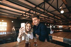 Couple taking selfie on mobile