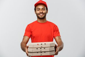 Delivery Concept - Portrait of Handsome African American Pizza delivery man. Isolated on Grey