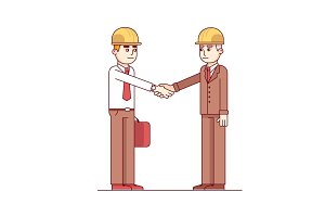 Business man and engineer standing shaking hands