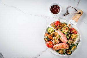 Grilled sausages and vegetables