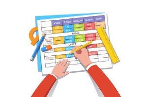 School teacher or student drawing a class schedule