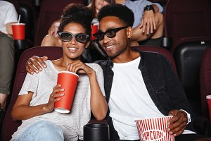 Happy afro american couple watching 3D movie