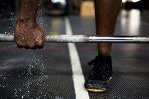 Black guy weight training at gym