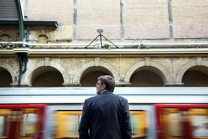 Businessman at a train station