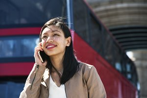 An Asian woman using a mobile phone