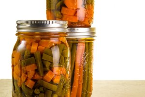 Beans and carrots in jars
