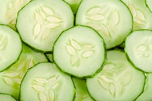 slices of cucumber as a background for salad