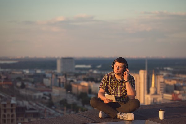 Man is listening to music on roof.