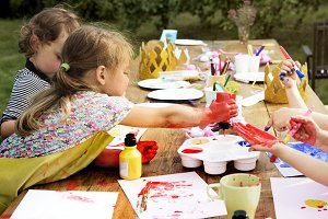 Kids painting in a garden