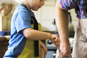 A little boy learning to bake