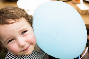 Cheerful girl with a balloon
