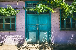 Purple wall and blue door