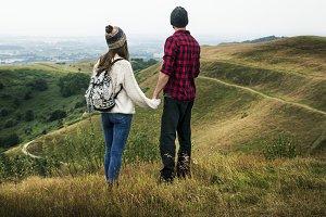 Couple exploring a mountain together