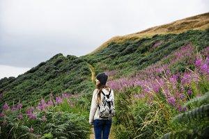 Woman traveler exploring a mountain