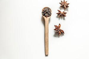 spices in a spoon isolated on white background,
