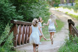 happy girls playing catch-up game