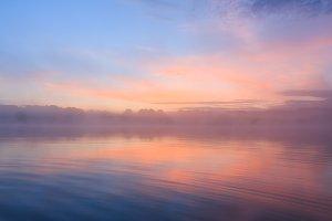 Misty sunrise lake France