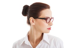 Profile of beautiful business woman with eyeglasses.