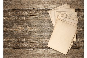 0001 Paper on Wooden Background