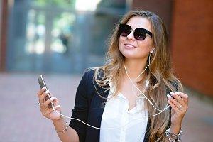 Business lady phone music headphones