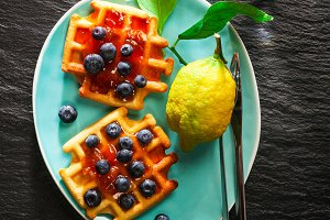 waffles with jam and blueberries