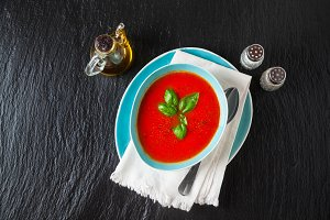Tomato soup on black stone backgroun
