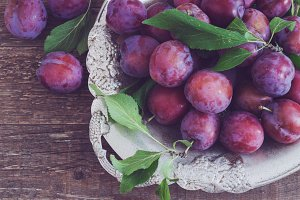 plums on a wooden rustic table.