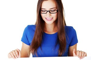 Young beautiful casual woman holding copy space.
