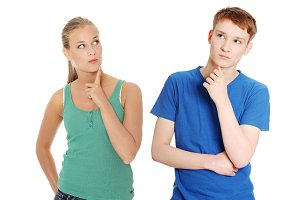 Two young people with finger on chin.