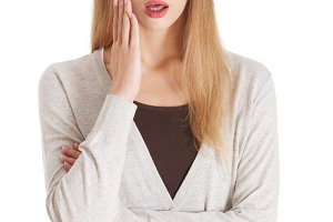 Beautiful casual woman with open mouth, expressing shock.