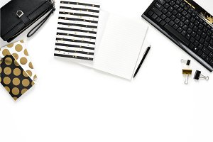 Flat lay photo of women office white desk with wallet, keyboard and gold notebook copy space background