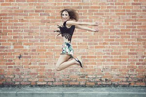 Young smiling woman jumping in air