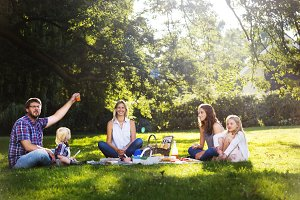 Happy family picnic in a garden