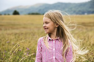 Cheerful girl in a meadow