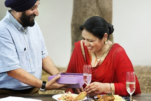 Indian couple celebrating dining