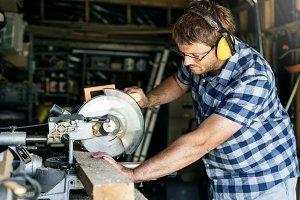 Man working on woodwork machine