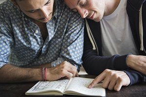 Gay couple reading book