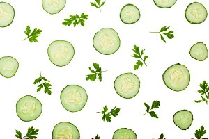 Cucumber slices and parsley leaves isolated on white background. Top view